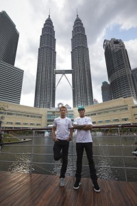 Nico Rosberg (left) and Lewis Hamilton pose with Twin Towers as background in a promotional event of Petronas in KL on Wednesday. A Petronas Mercedes team photo