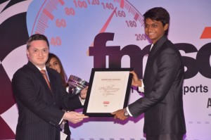 Gautam Singhania presenting the Man of the year award to Vishnu Prasad. An Adrenna Communications photo