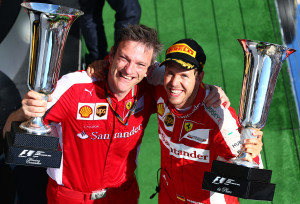 Sebastian Vettel poses with the trophy along with a Ferrari engineer after winning the Hungarian GP on Sunday. A Shell Motorsport image