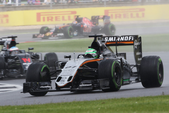 Hulkenberg in rain on way to 7th in the British GP behing Perez (not in pic) in 6th. A Sahara Force India image