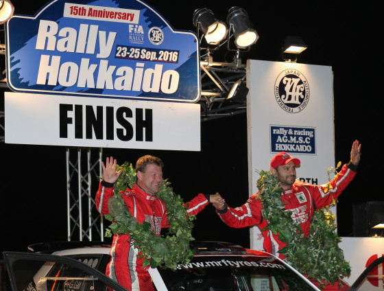 gaurav-gill-and-stephane-prevot-celebrate-on-the-podium-after-winning-rally-hokkaido-on-sunday