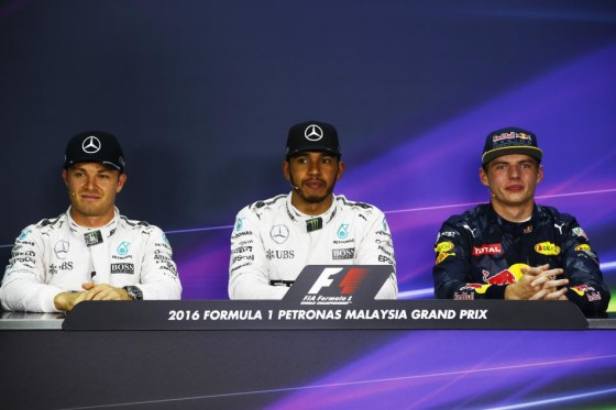 Hamilton (centre) take pole at Sepang to fight for championship lead with teammate Rosberg (left). An FIA image